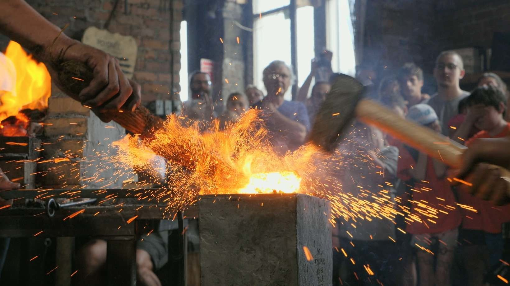 Sparks fly from blacksmithing