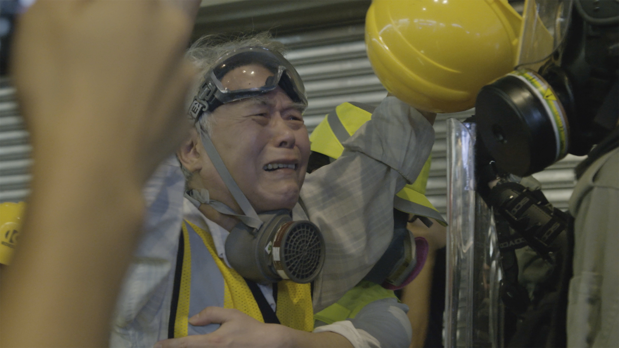 Person wearing protective gear crying