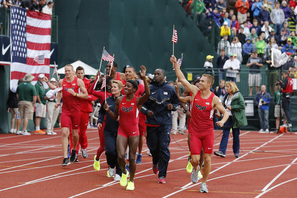 Members of Team USA take to Hayward Field in their USATF Olympic Uniforms