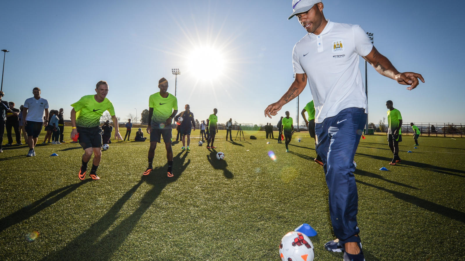 Lescott in training with young footballers