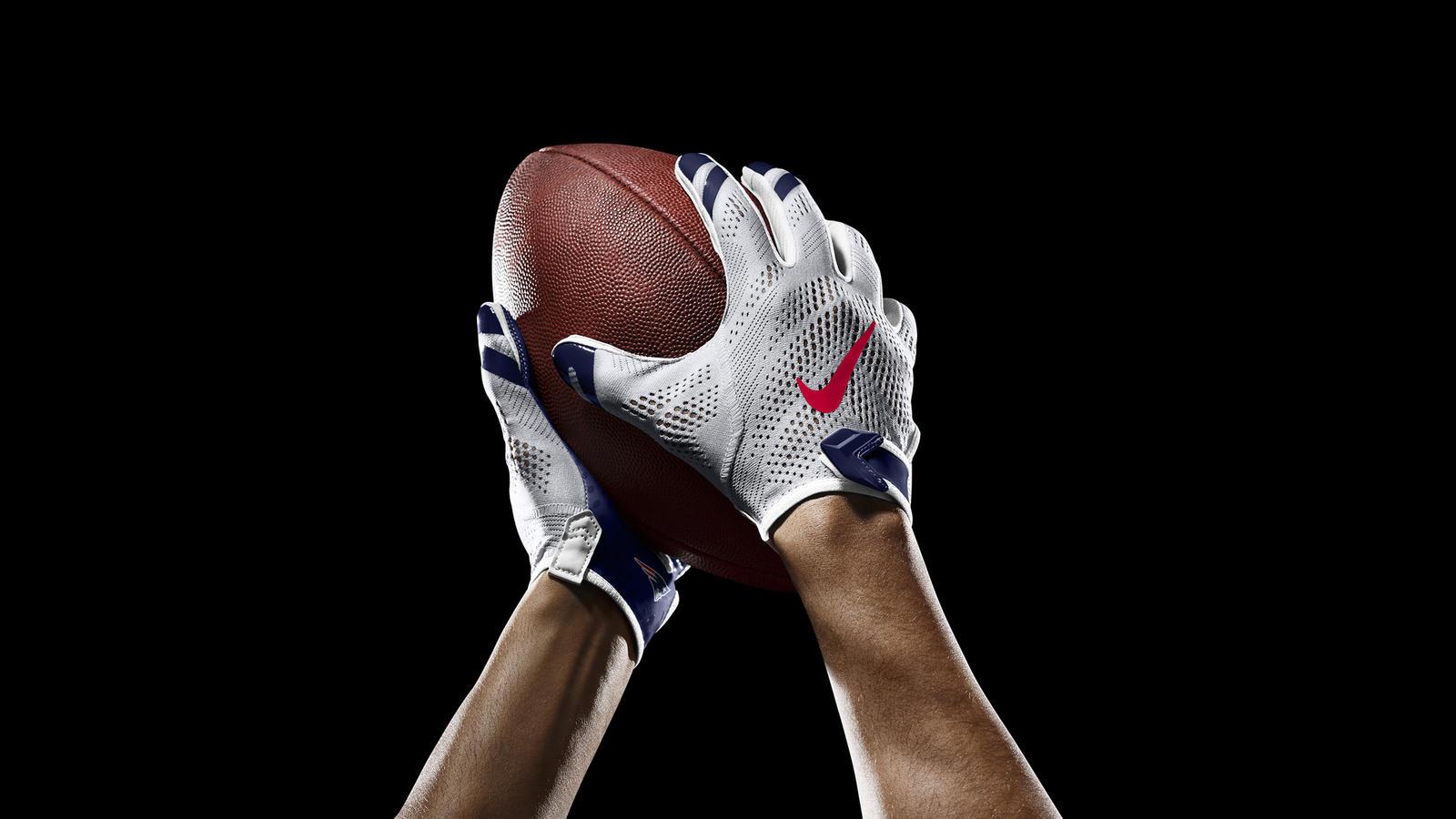 SP14_NFL_SB_TeamGloves_Ball_Patriots