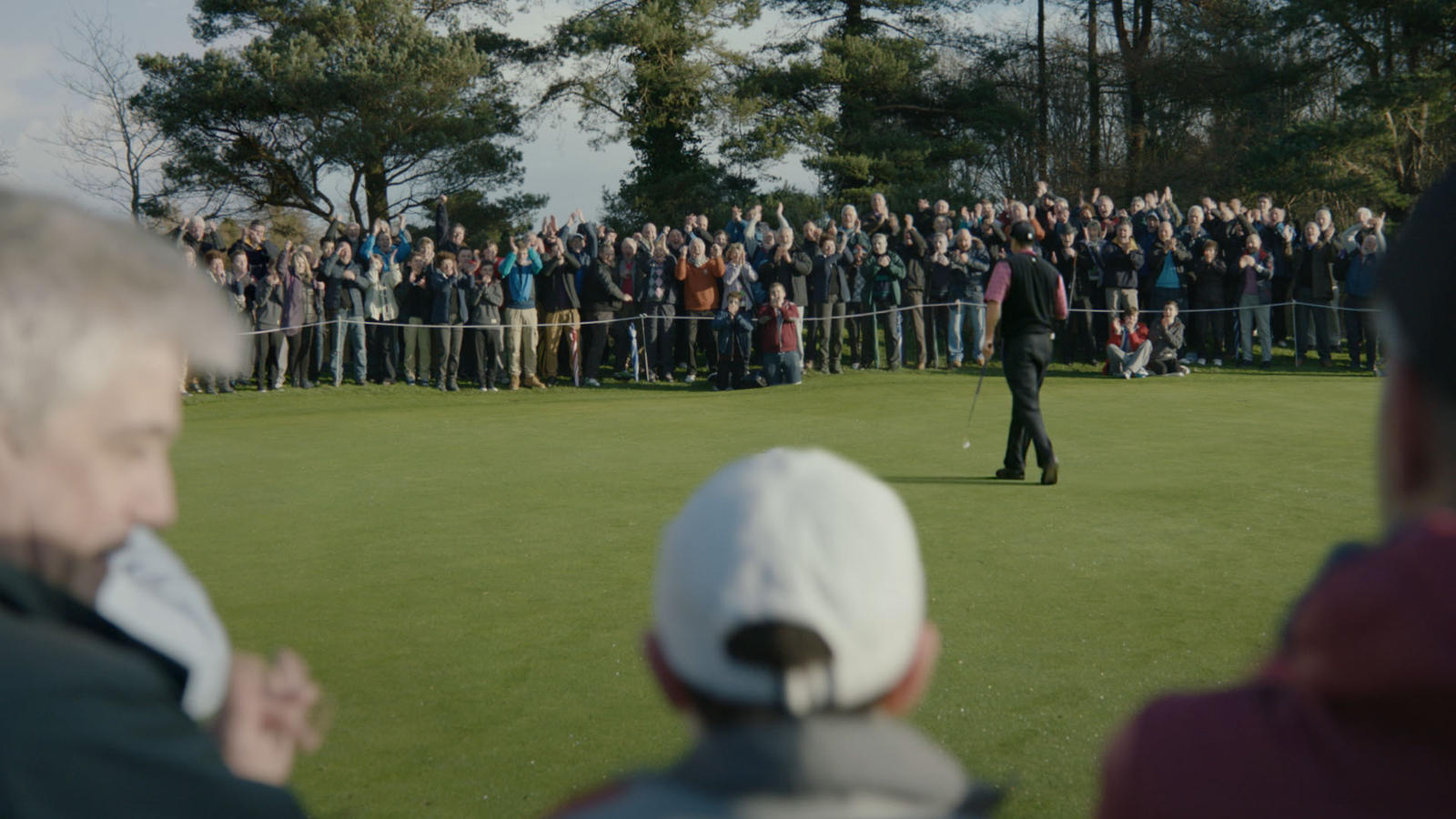 Rory Watching Tiger on Course