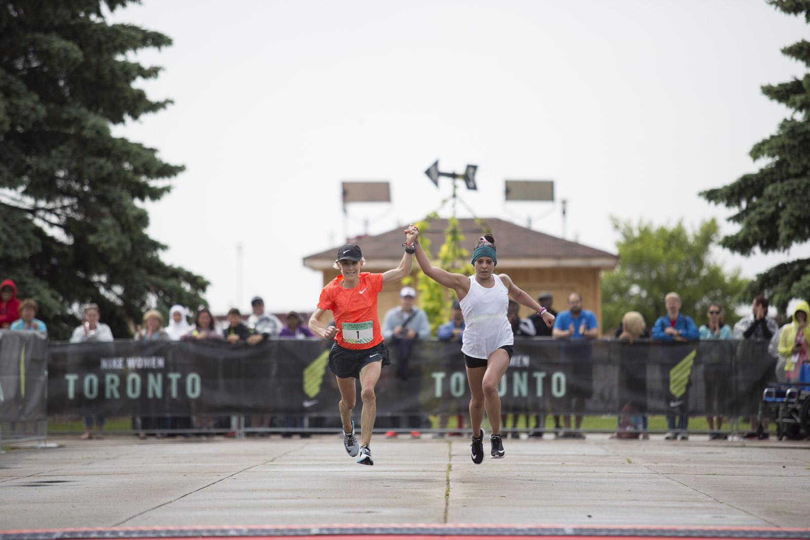 Joan Benoit Samuelson and Marlen Esparza approach finish line
