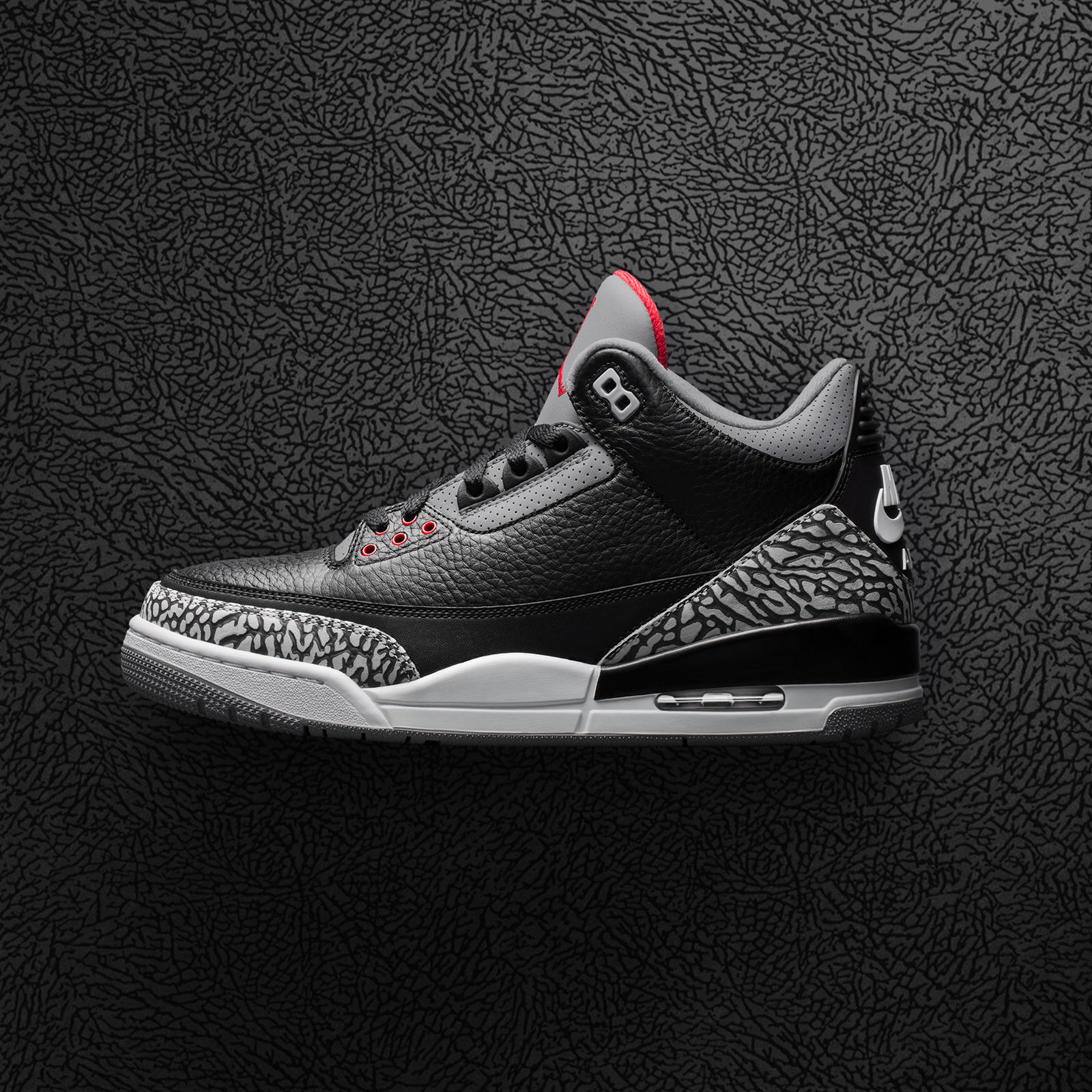 "Worn by Michael Jordan during the 1988 All-Star Game, the Black Cement Air  Jordan III returns in true OG form, including ""Nike Air"" branding on the  heel."