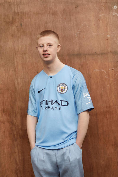343289a0e45 Members of Manchester City's Community Foundation (CITC) Help Unveil Club's  2018-19 Kit - Nike News
