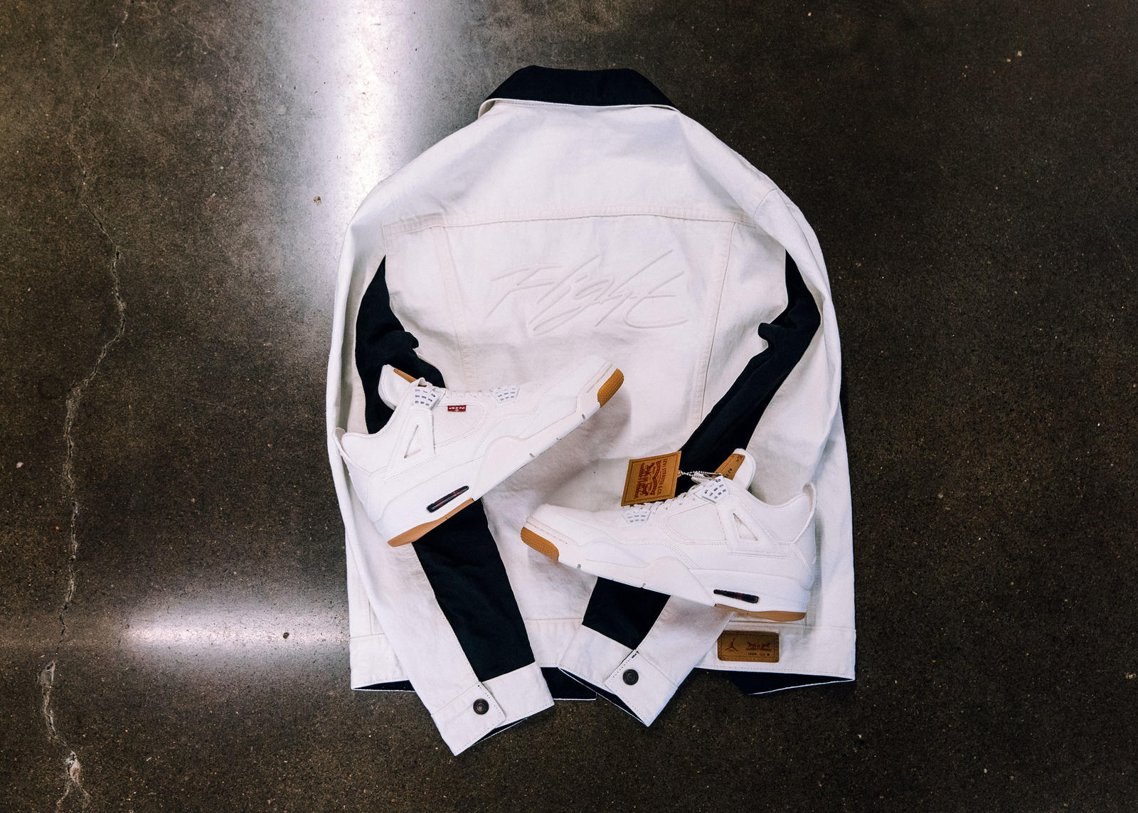 the second edition: JORDAN BRAND X LEVI'S® AIR JORDAN IV AND REVERSIBLE TRUCKER JACKET White and black 4