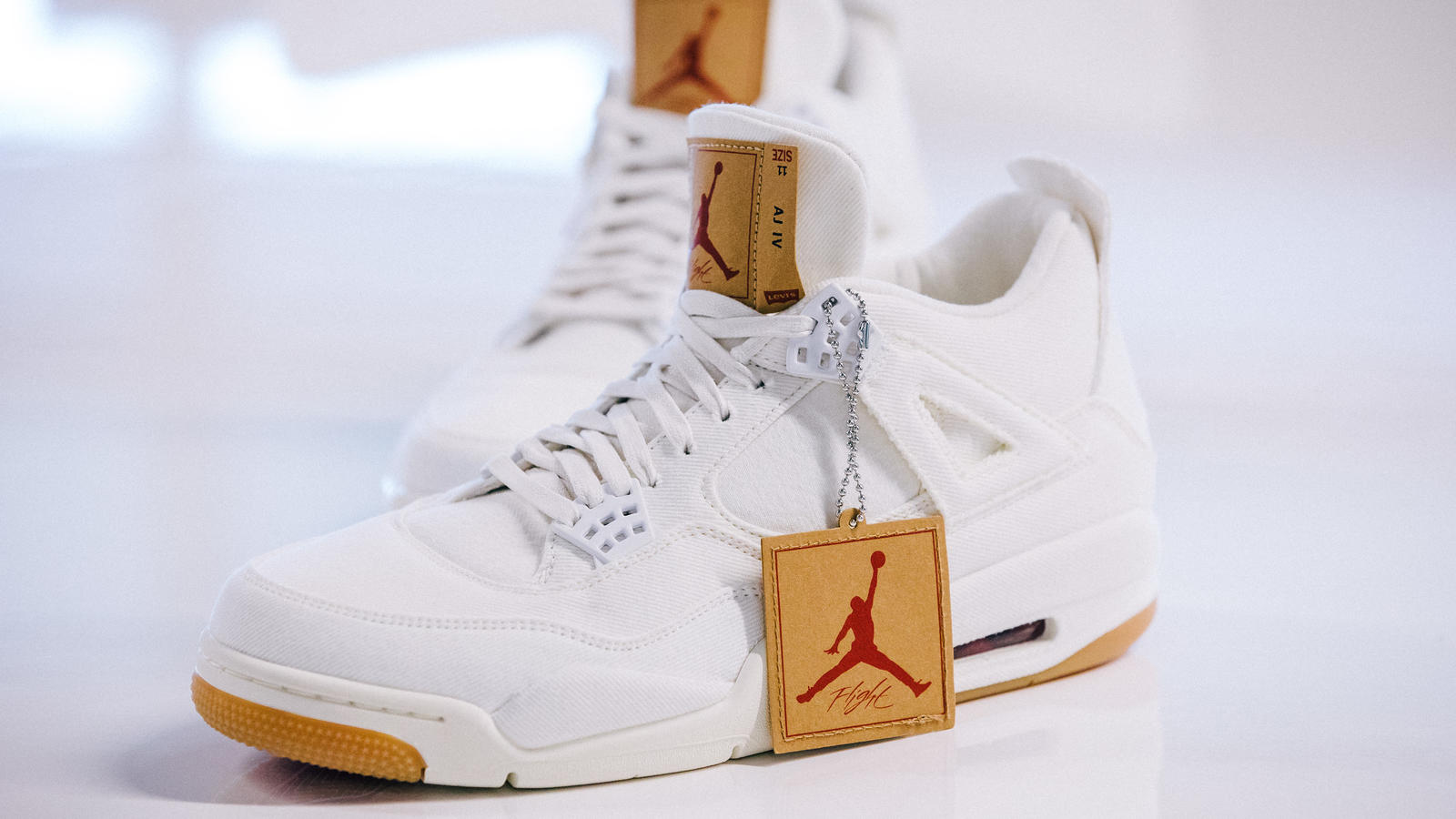 the second edition: JORDAN BRAND X LEVI'S® AIR JORDAN IV AND REVERSIBLE TRUCKER JACKET White and black 6