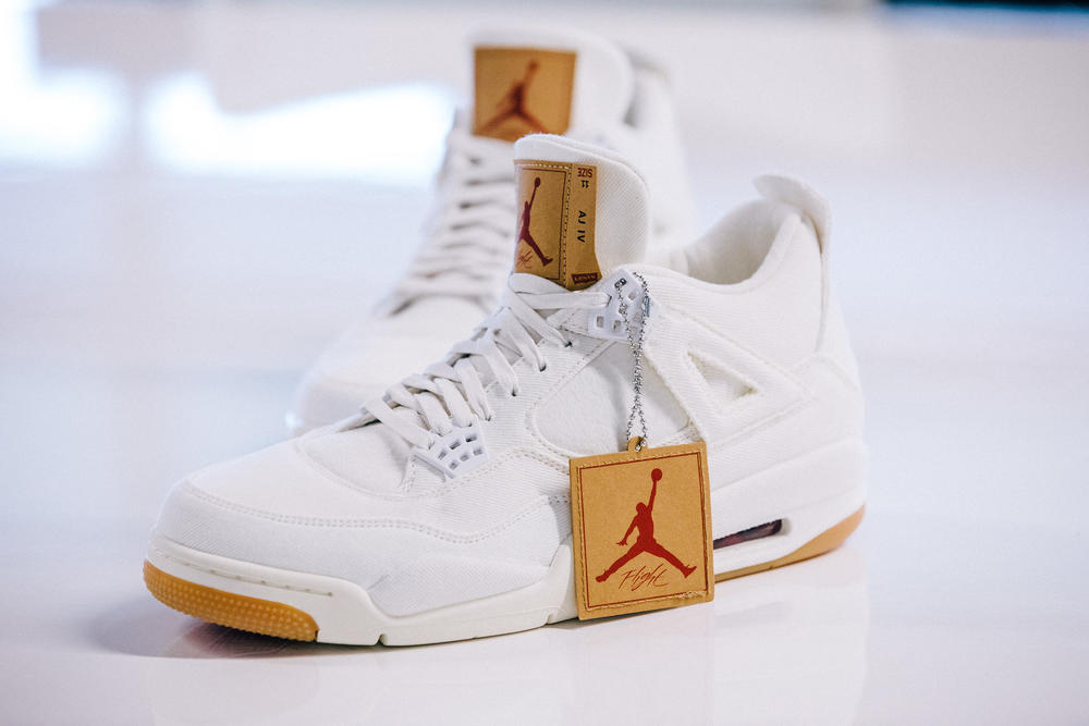 The Jordan Brand x Levi's® Air Jordan IV and Reversible Trucker Jacket in White and black