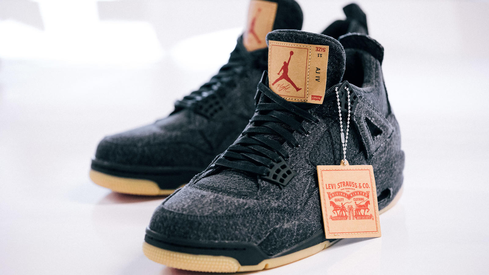 the second edition: JORDAN BRAND X LEVI'S® AIR JORDAN IV AND REVERSIBLE TRUCKER JACKET White and black 9
