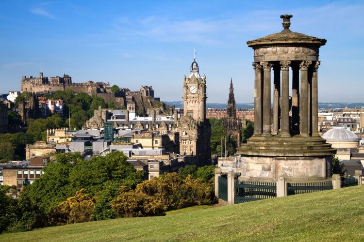 Edinburgh-Scotland-view-from-Calton-Hill-with-the-Dugald-Stewart-monument-Scott-monument-and-Balmoral-clock-tower