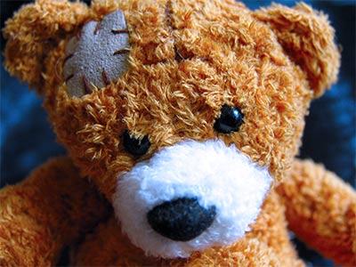 Teddy bear with a patch like a bald spot