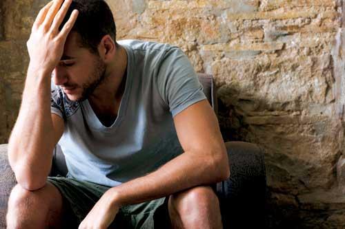 Depressed dad suffering from paternal postnatal depression (PPND)
