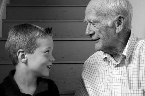 child making small talk with grandpa