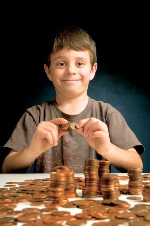 Boy collecting coins
