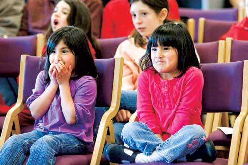 Children enjoying live theater