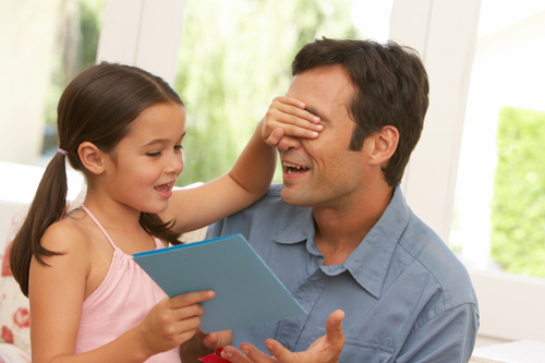 Girl giving Dad a Father's Day card