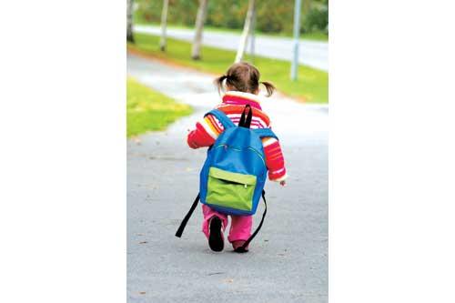 Little girl wishing she was in kindergarten