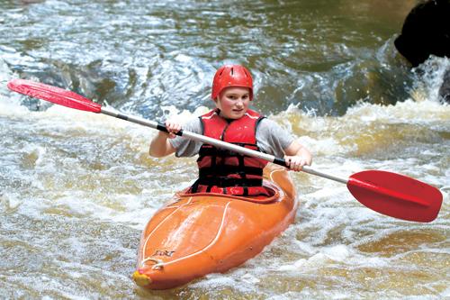 Teen on an adventurous summer camp experience