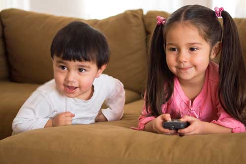 Young children playing video games