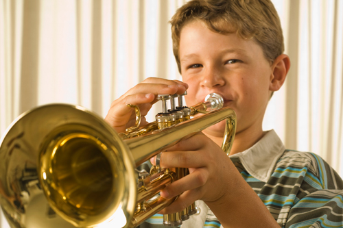 Boy taking music lessons