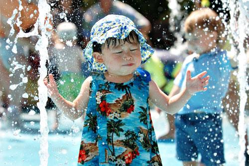 Children cooling off at spray parks