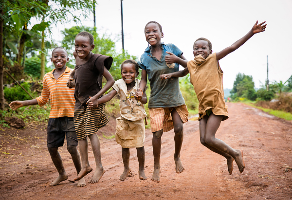 smiling kids jumping