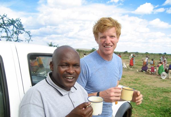 men holding coffee mugs