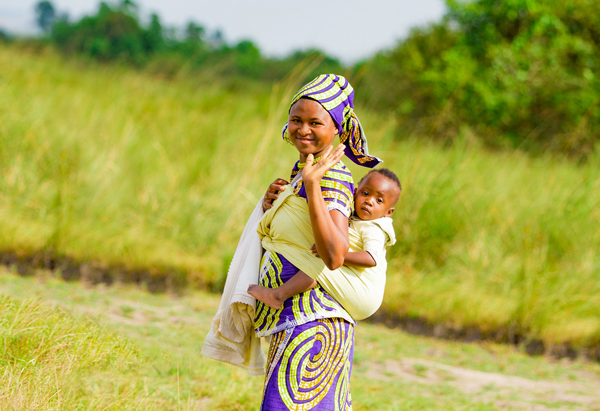 happy woman carrying child