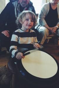 Wisdom child banging drum