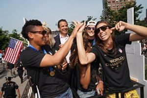 Cuomo signs pay equity legislation at parade celebrating US Women's Soccer Team