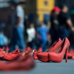 In Mexican capital, red shoes to protest killings of women