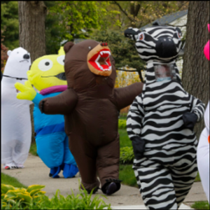Detroit-area residents lift spirits with costumed parades