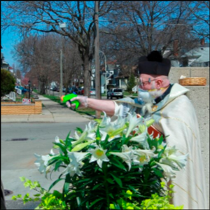 Priest draws squirt gun in fight against coronavirus