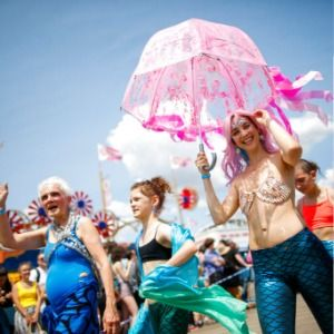 Woody Guthrie's children named Mermaid Parade king and queen