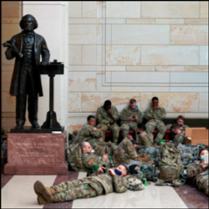 A day of historic impeachment, a Capitol as armed encampment