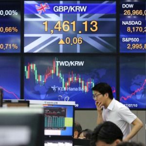 Asian shares climb after US benchmarks hit record highs