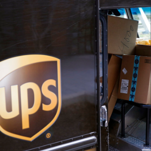 UPS deftly navigates shipping surge, hit by pension charge