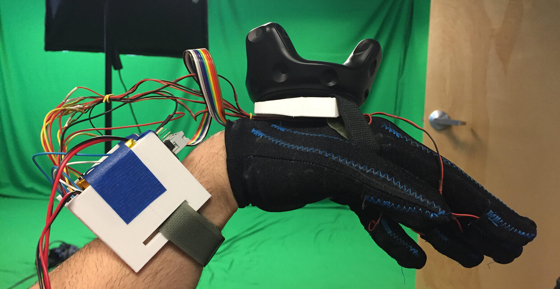 Virtual reality haptic glove with tracker