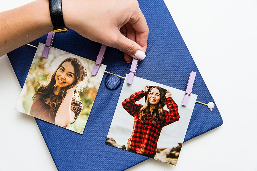 Pin print to twine using mini clothespins
