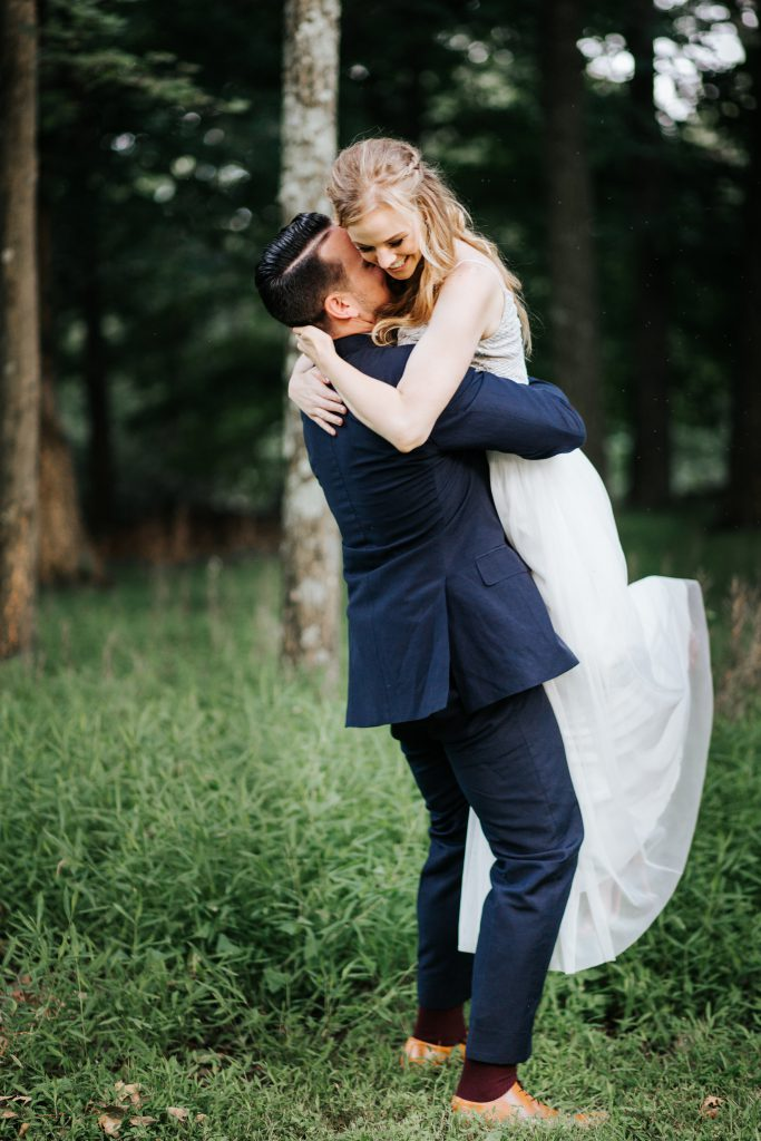Husband and Wife Hugging First Look