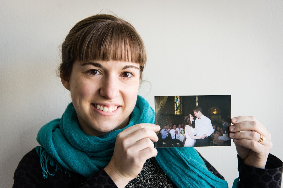 holding up photo of couple