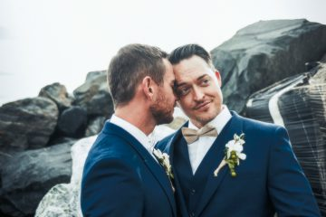 Two men pose on their wedding day