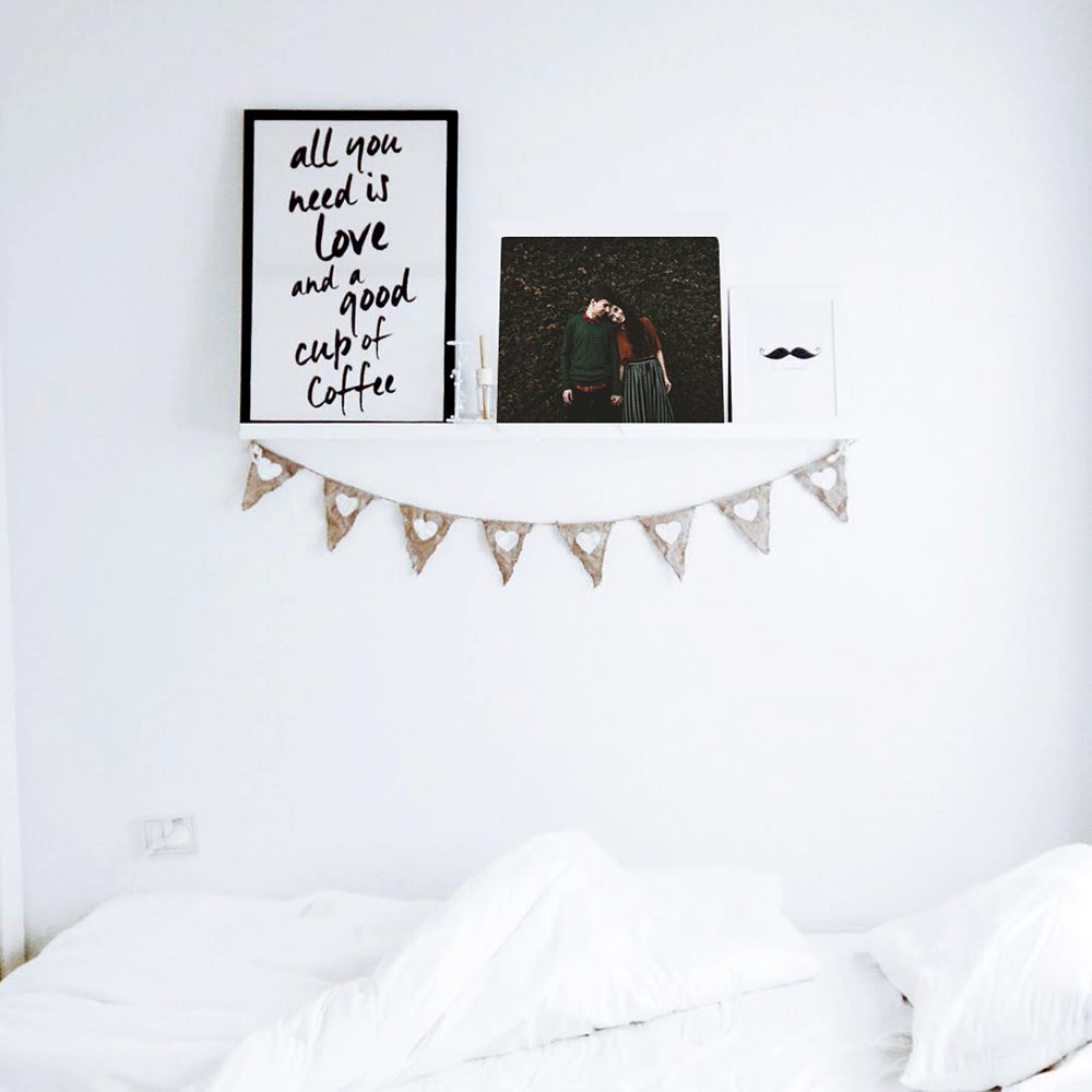 Canvas print hanging over bed