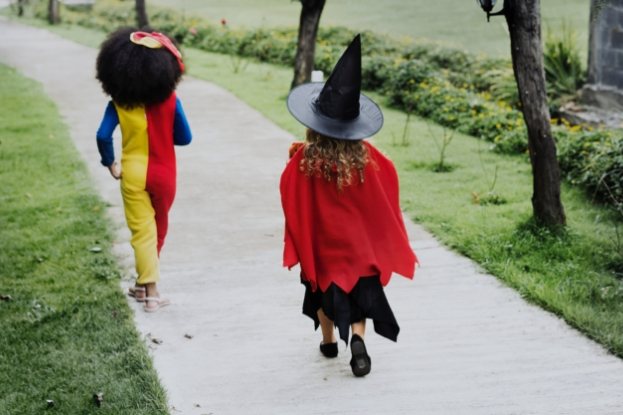 Two young girls in costume on Halloween