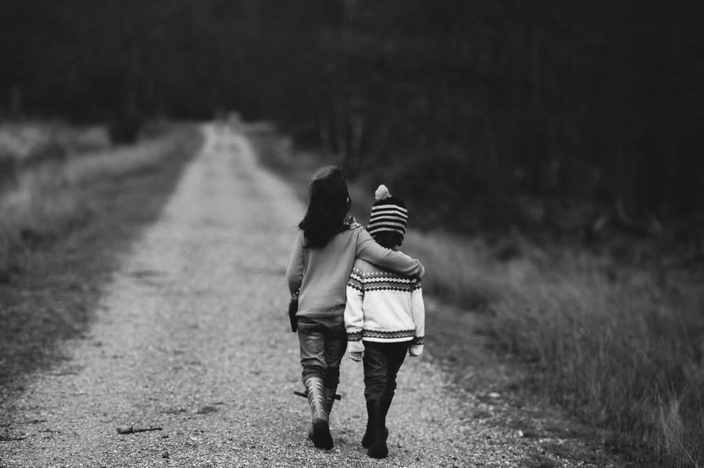 kids walking through wooded area