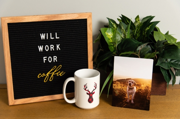 Desk setup with metal print, photo mug