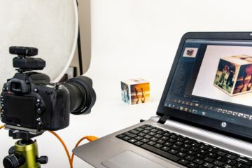 A tethered camera pointing at a laptop
