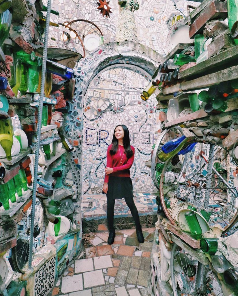 Woman standing in Magic Gardens in Philadelphia, PA