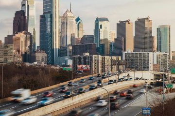 Rush hour traffic on I76 plus skyline in Philadelphia, PA
