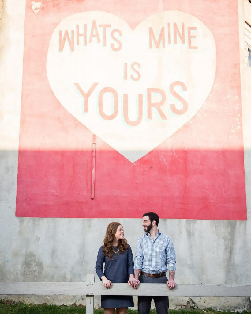 Couple standing in front of Love Letters Mural in Philadelphia, PA